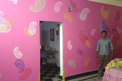STRENCHIL-DESIGNS-ON-PINK-COLOUR-WALL