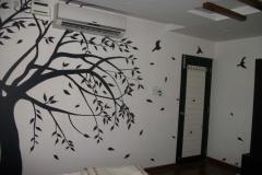 TREE-AND-BIRD-DESIGN-ON-AC-WALL